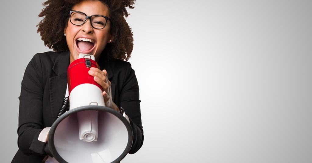 woman-with-megaphone-promoting-webinar.jpg